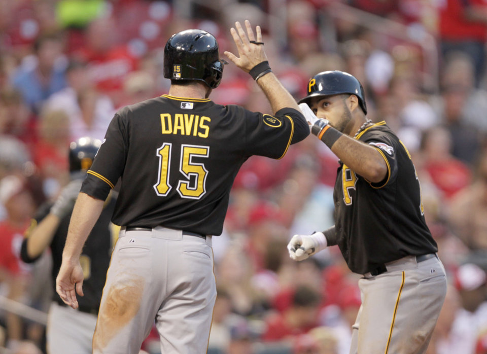Photo - Pittsburgh Pirates' Ike Davis (15) celebrates with Pedro Alvarez after he hit a two-run home run in the fourth inning of a baseball game against the St. Louis Cardinals, Tuesday, July 8, 2014 in St. Louis. (AP Photo/Tom Gannam)