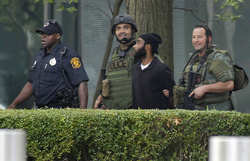 Photo -   Pittsburgh police and SWAT members escort a suspect, center right, from a hostage-taking on the 16th floor at Three Gateway Center to a police van on Friday, Sept. 21, 2012, in Pittsburgh. Klein Michael Thaxton, 22, surrendered just before 2 p.m., and the man he took hostage was unhurt, Police Chief Nathan Harper said. (AP Photo/Keith Srakocic)