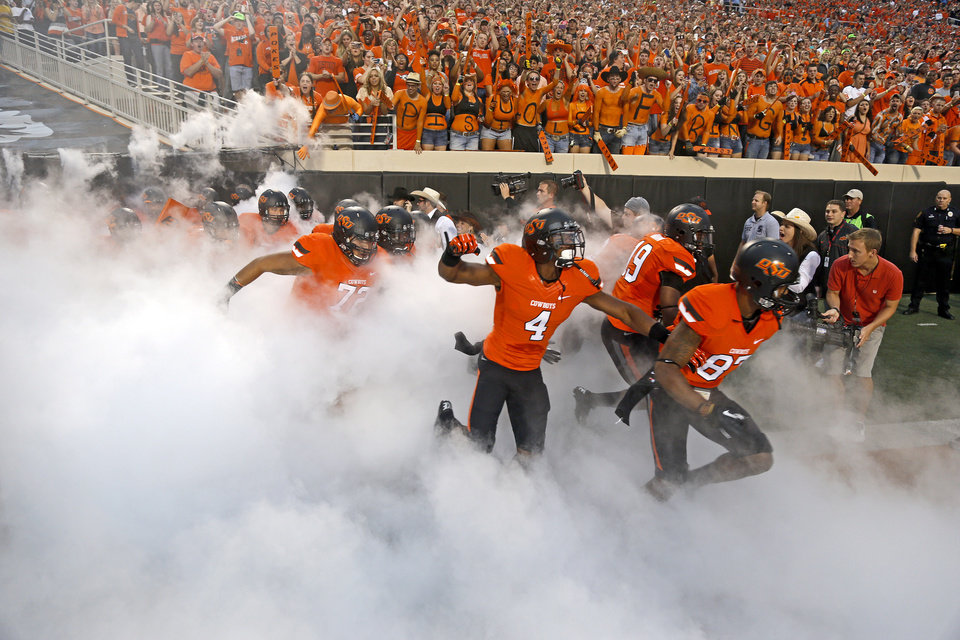 Photo - Oklahoma State takes the field before a college football game between Oklahoma State University (OSU) and the University of Texas (UT) at Boone Pickens Stadium in Stillwater, Okla., Saturday, Sept. 29, 2012. Photo by Bryan Terry, The Oklahoman