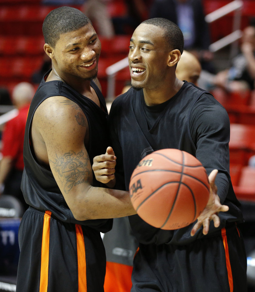 Photo - OSU's Marcus Smart, left, and Markel Brown joke around during a practice the day before Oklahoma State's second round game of the NCAA men's college basketball tournament at Viejas Arena in San Diago, Thursday, March 20, 2014. Oklahoma State will face Gonzaga in their NCAA Tournament game on Friday, March 21, 2104. Photo by Bryan Terry, The Oklahoman