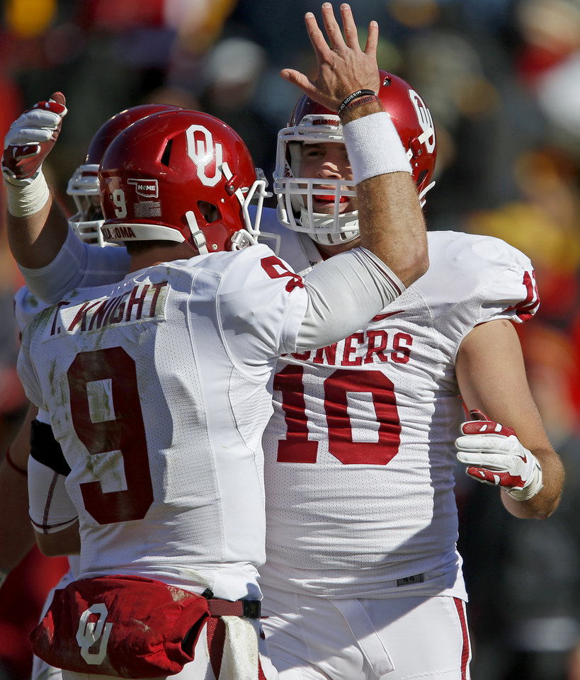 Photo - Oklahoma's Blake Bell (10) celebrates with Trevor Knight (9) after a touchdown during a college football game between the University of Oklahoma Sooners (OU) and the Iowa State Cyclones (ISU) at Jack Trice Stadium in Ames, Iowa, Saturday, Nov. 1, 2014. Photo by Bryan Terry, The Oklahoman