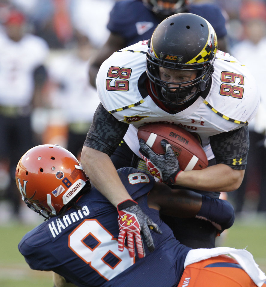 Photo -   Maryland tight end Matt Furstenburg (89) gains extra yardage over Virginia safety Anthony Harris (8) during the second half of an NCAA college football game in Charlottesville, Va., Saturday, Oct. 13, 2012. Maryland won 27-20. (AP Photo/Steve Helber)