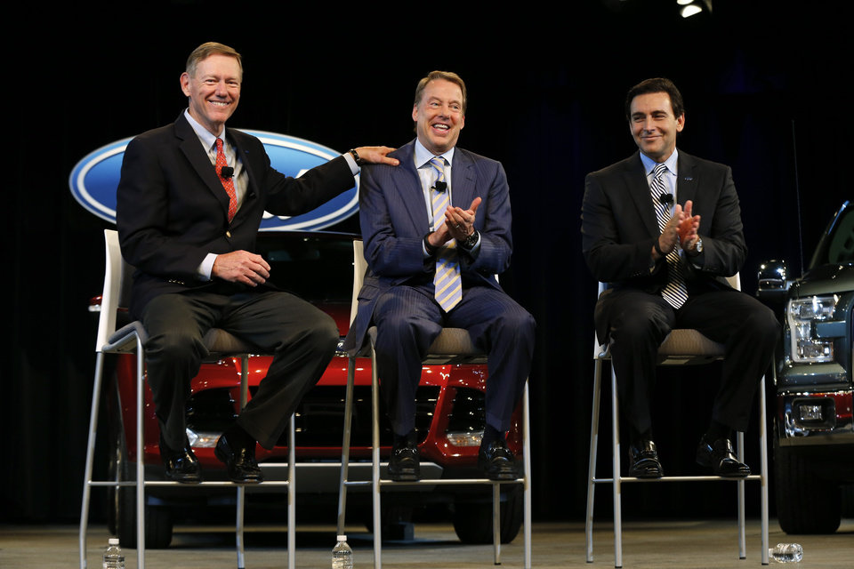 Photo - Ford Motor Company President and CEO Alan Mulally, from left, Executive Chairman Bill Ford Jr., and Chief Operating Officer Mark Fields appear during a news conference in Dearborn, Mich., Thursday, May 1, 2014. Ford announced CEO Alan Mulally will retire July 1 and be replaced by Fields. (AP Photo/Paul Sancya)