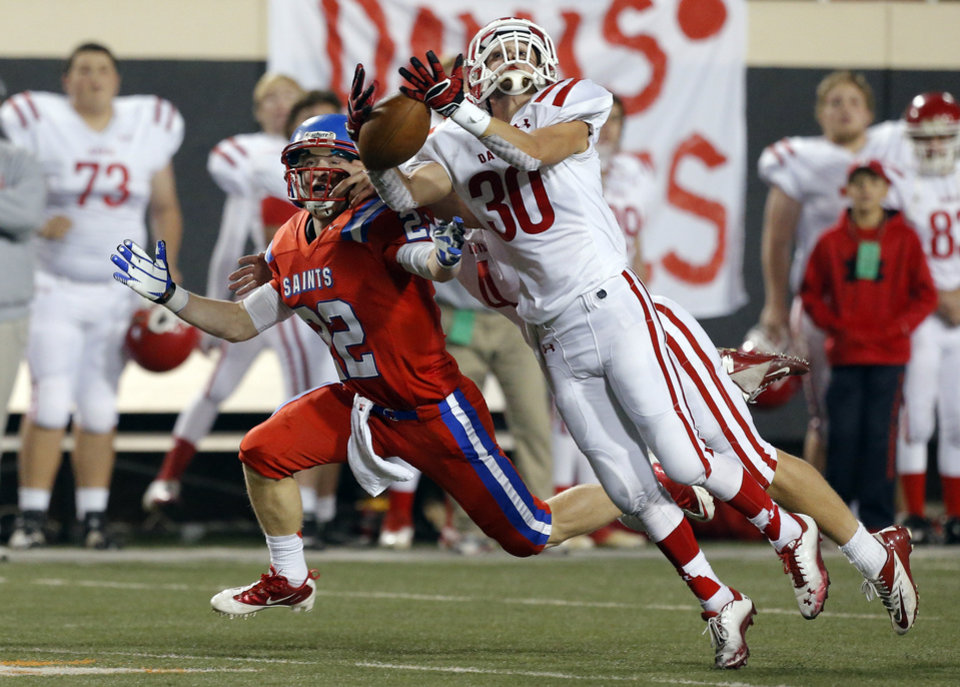 Davis' Jordan Willson breaks up a pass intended for OCS' Connor Sikes during the Class 2A high school football championships between Davis and Oklahoma Christian School at Boone Pickens Stadium in Stillwater, Okla.,  Saturday,Dec. 8, 2012. Photo by Sarah Phipps, The Oklahoman