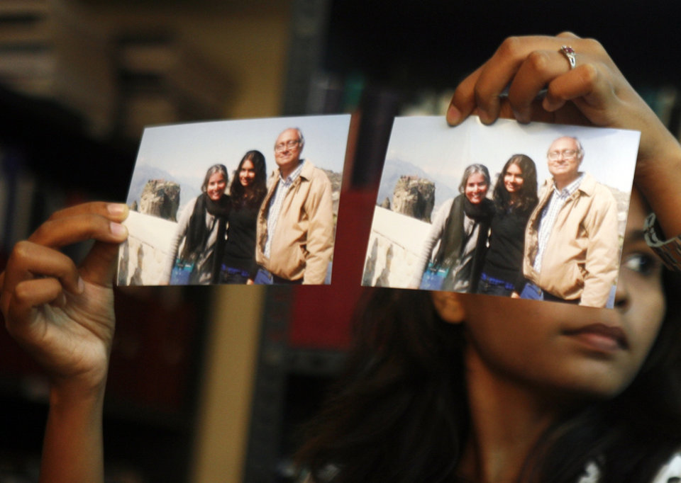 Photo - Photographs showing one of the passengers of the missing Malaysian Airlines aircraft Chandrika Sharma, left, her husband Narendran and daughter Meghna, are displayed during a press conference in Chennai, India, Wednesday, March 12, 2014. Narendran criticized the Indian government for its 'silence' and said no government official has contacted them on the incident yet, according to a local news agency. Malaysia has asked for India's assistance in searching for the missing Boeing 777 jetliner to widen the search to an area near the Andaman Sea, an Indian official said Wednesday. (AP Photo/Arun Sankar K)