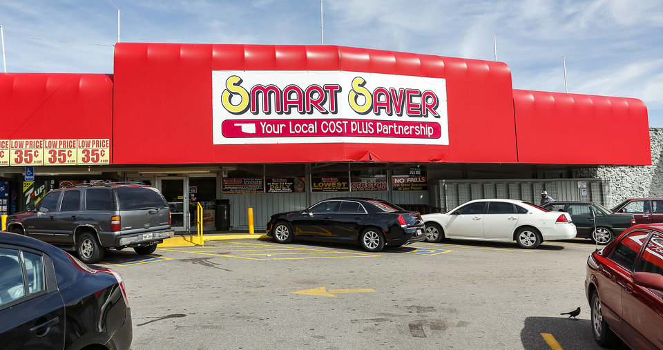 Photo -  The former Buy For Less grocery store at NE 23 and Martin Luther King now is a Smart Saver store. [Photo by Chris Landsberger, The Oklahoman]