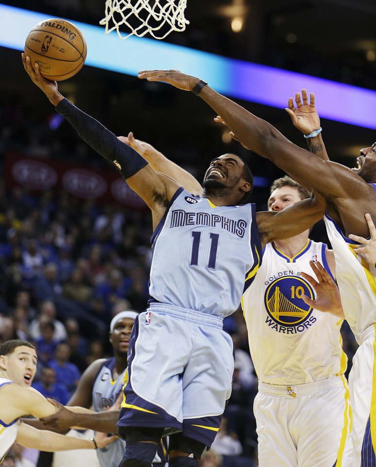 Memphis Grizzlies' Mike Conley (11) shoots against Golden State Warriors' David Lee (10) during the first half of an NBA basketball game, Wednesday, Jan. 9, 2013, in Oakland, Calif. (AP Photo/Ben Margot)