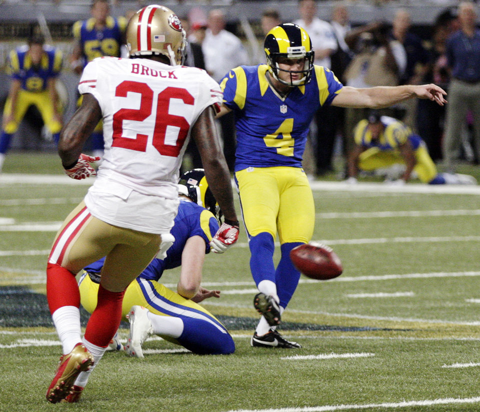 Photo - St. Louis Rams kicker Greg Zuerlein, (4) makes a 54-yard field goal as San Francisco 49ers' Tramaine Brock, left, watches during overtime of an NFL football game, Sunday, Dec. 2, 2012, in St. Louis. The Rams won 16-13. (AP Photo/Tom Gannam)