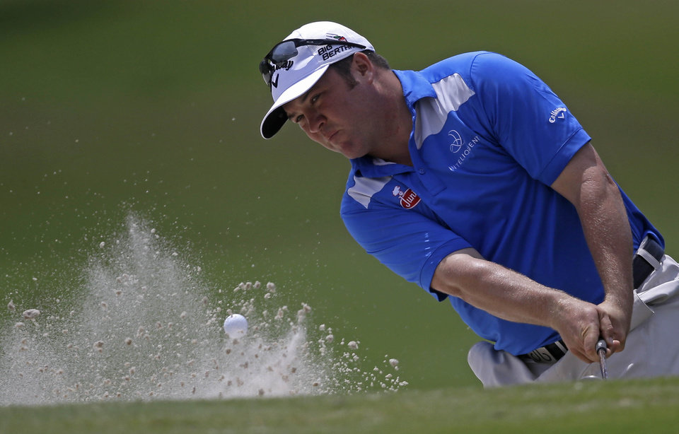 Photo - Andrew Svoboda hits out of the sand onto the 18th green during the opening round of the Zurich Classic golf tournament at TPC Louisiana in Avondale, La., Thursday, April 24, 2014.  (AP Photo/Gerald Herbert)