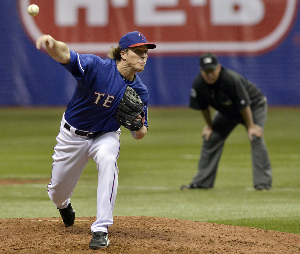 Texas Rangers' Daniel McCutchen pitches during a spring exhibition baseball game against the Houston Astros on Saturday, March 29, 2014, in San Antonio. (AP Photo/Darren Abate)