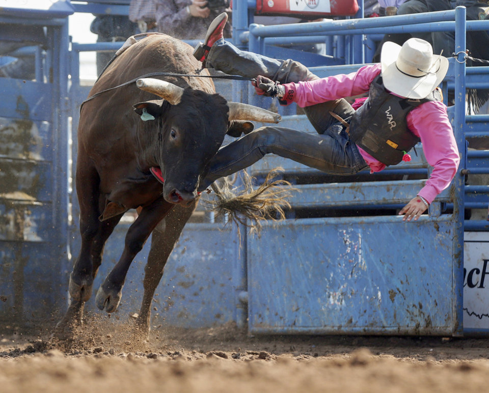 Photo - Josiah Chism of Sperry, Okla., competes in bull riding during the International Finals Youth Rodeo at the Heart of Oklahoma Exposition Center in Shawnee, Okla., Thursday morning, July 11, 2019. [Nate Billings/The Oklahoman]