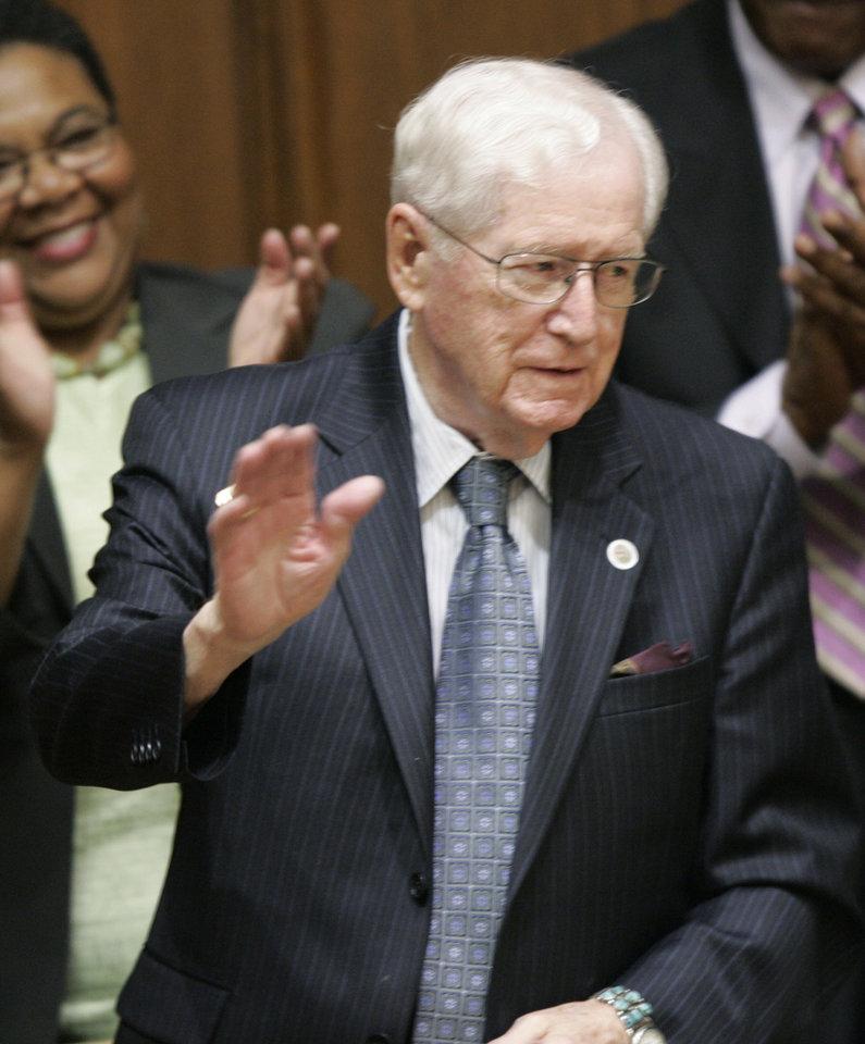 FILE - In this Tuesday, Jan. 15, 2008 file photo. former Indiana Gov. Otis Bowen is acknowledged by Gov. Mitch Daniels during the State of the State address to a joint session of the Legislature at the Statehouse in Indianapolis. Bowen, a former U.S. Health and Human Service secretary, has died. He was 95. Gov. Mike Pence said Bowen died Saturday, May 4, 2013. Pence didn't disclose the cause of death. (AP Photo/AJ Mast, File)