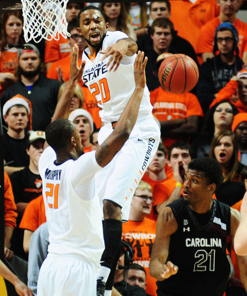 Oklahoma State junior forward Michael Cobbins blocks a shot during Friday's game.  Photo by KT King, For the Tulsa World