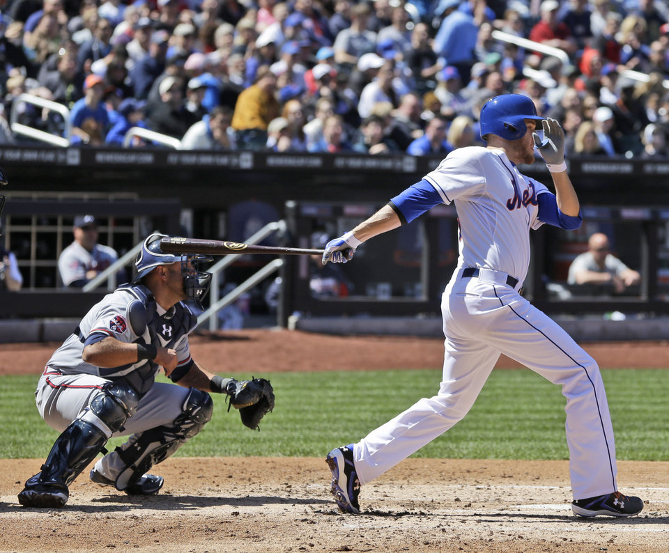 Photo - New York Mets' Zack Wheeler drives in a run during the second inning of a baseball game against the Atlanta Braves, Sunday, April 20, 2014 in New York. Wheeler was safe at first on Braves fielding error. (AP Photo/Seth Wenig)