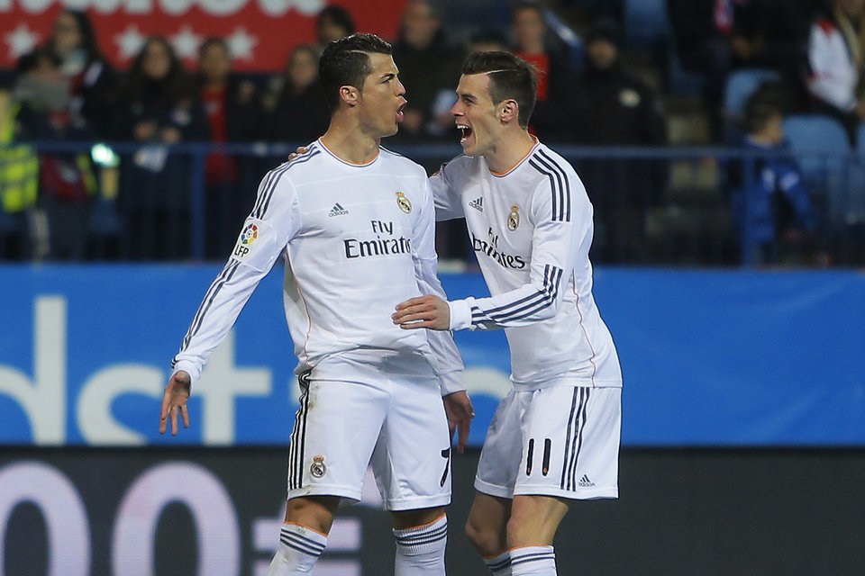 Photo - Real's Cristiano Ronaldo, left, celebrates his goal with teammate Gareth Bale during a semifinal, 2nd leg, Copa del Rey soccer match between Atletico de Madrid and Real Madrid at the Vicente Calderon stadium in Madrid, Spain, Tuesday Feb. 11, 2014. (AP Photo/Andres Kudacki)