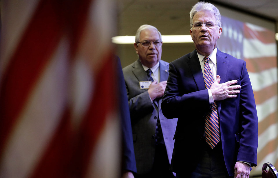 Photo - Former Senator Dr. Tom Coburn says the pledge of allegiance before speaking  at the Rotary Club of Tulsa April 25, 2018.  MIKE SIMONS/Tulsa World