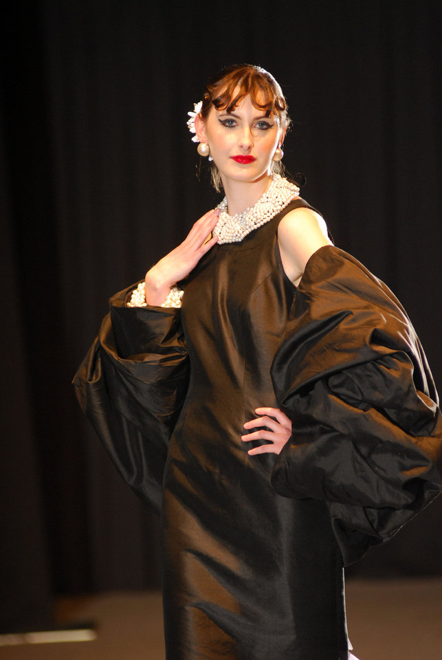 Photo - For the Hollywood Black and White category of the 2010 Dallas Designers Display Competition, Stella Thomas created this black silk satin gown with a bubble wrap and pearl bib necklace. Photo provided.