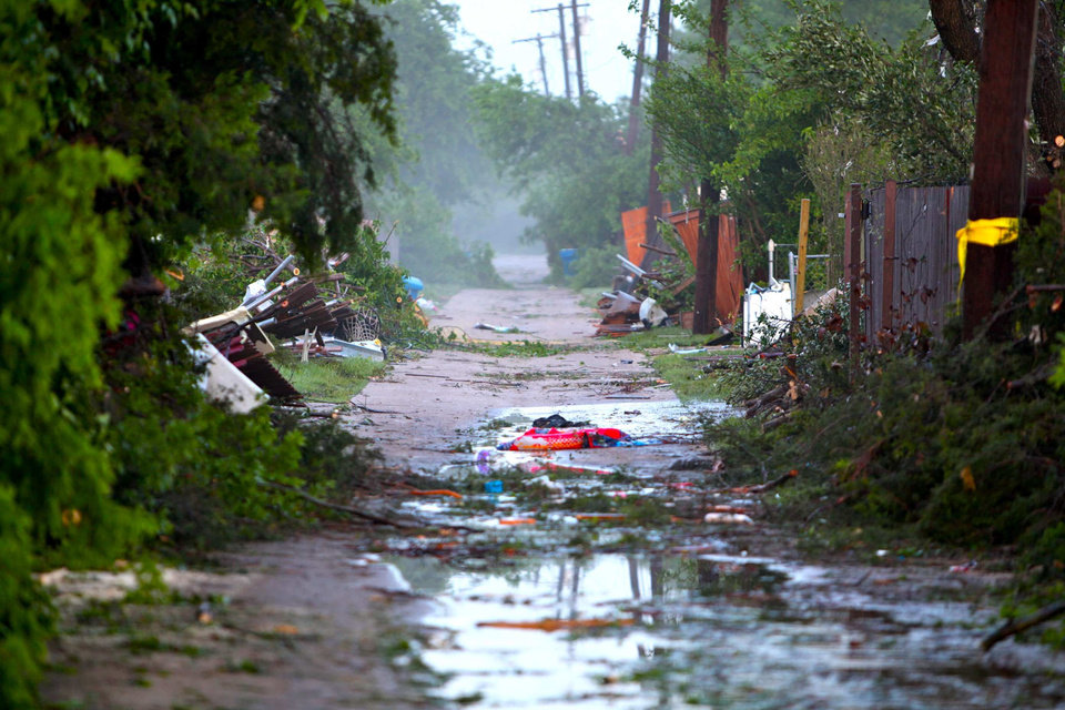 Photo -   As first light rises over Lancaster, Texas on Wednesday, April 4, 2012, the devastation from a tornado on Tuesday runs a mile long down a series of neighborhoods. The National Weather Service says possibly as many as a dozen twisters moved across the Dallas-Fort Worth area Tuesday, bouncing in and out of neighborhoods, and destroying homes at random. The Red Cross estimates that 650 homes were damaged in Lancaster, one of the hardest hit areas. (AP Photo/Robert Ray)