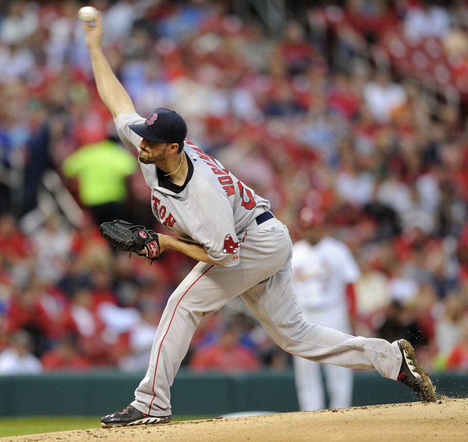 Photo - Boston Red Sox's starting pitcher Brandon Workman (67) throws against the St. Louis Cardinals in the first inning in a baseball game, Thursday, August 7, 2014, at Busch Stadium in St. Louis. (AP Photo/Bill Boyce)