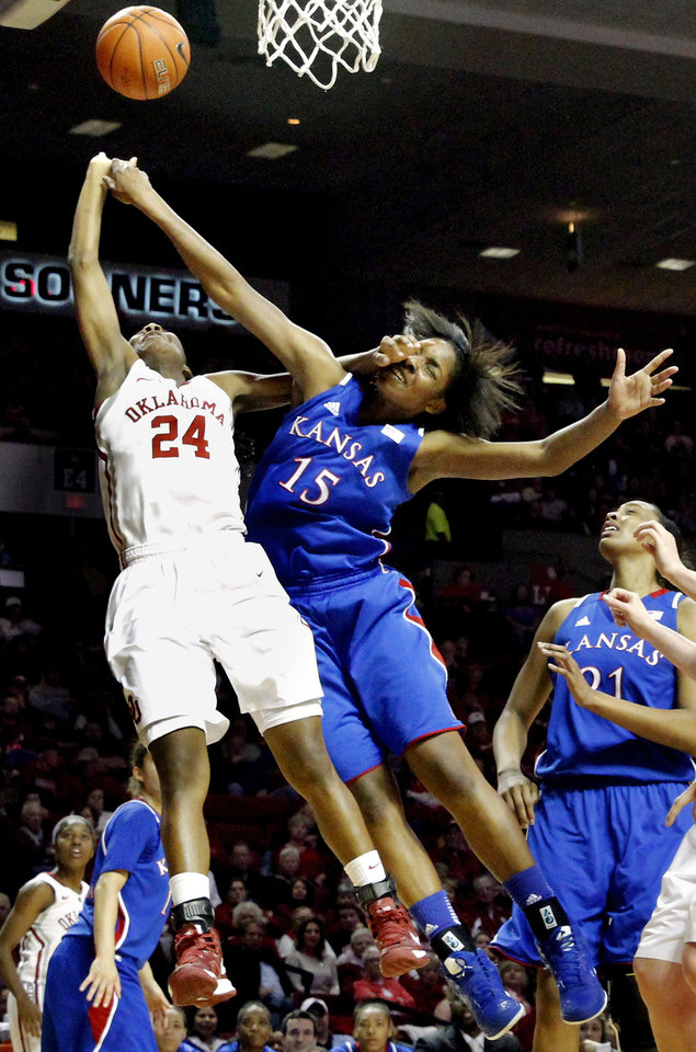 Photo - Kansas Jayhawks' Chelsea Gardner (15) tries to block a shot by Oklahoma Sooner's Sharane Campbell (24) as the University of Oklahoma Sooners (OU) play the Kansas Jayhawks in NCAA, women's college basketball at The Lloyd Noble Center on Saturday, March 2, 2013  in Norman, Okla. Photo by Steve Sisney, The Oklahoman