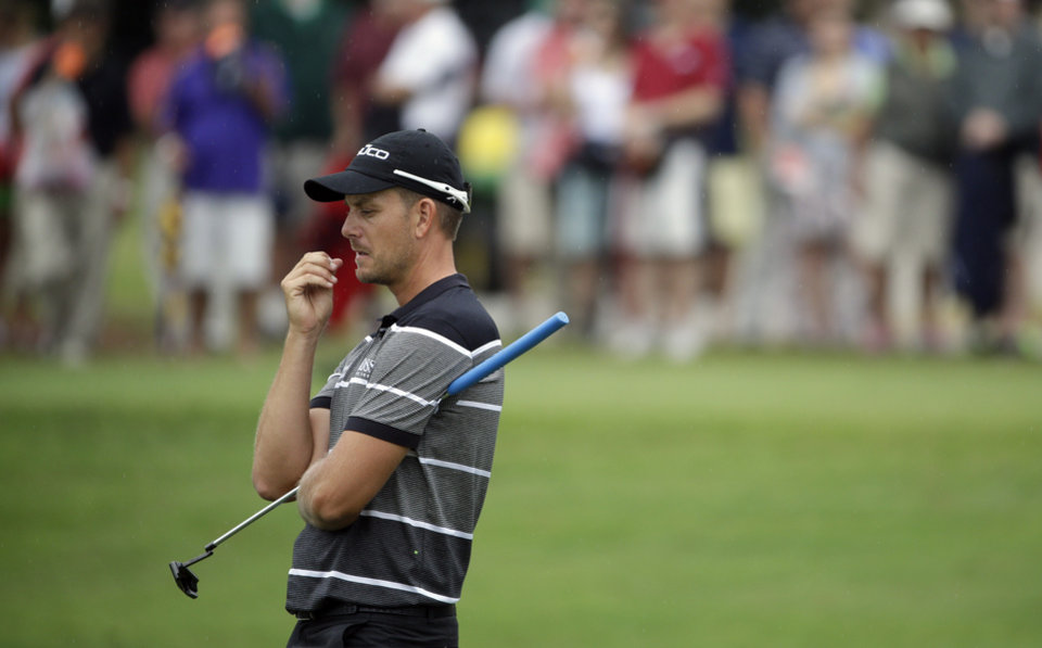 Photo - Henrik Stenson, of Sweden, waits to putt on the sixth hole during the third round of play in the Tour Championship golf tournament at East Lake Golf Club, in Atlanta, Saturday, Sept. 21, 2013. (AP Photo/David Goldman)
