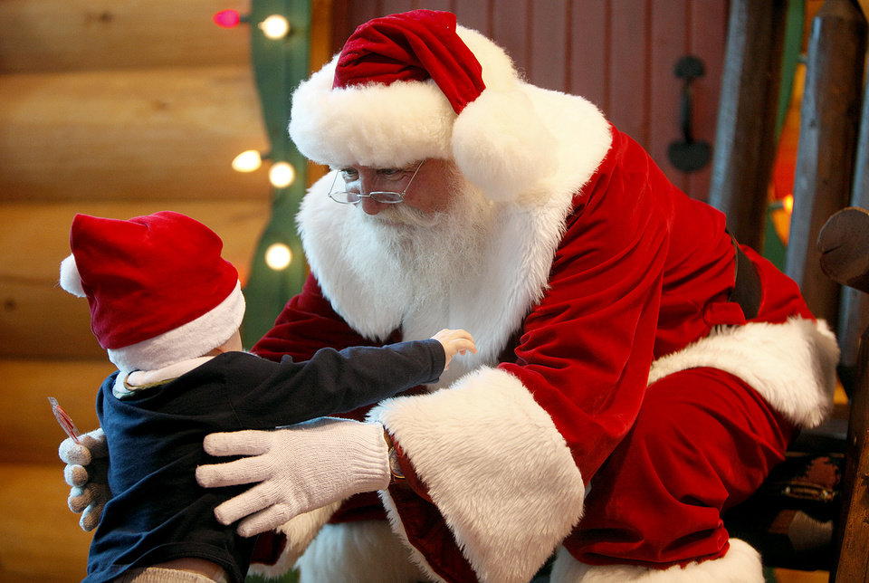 Photo - CHILD / CHILDREN / KIDS: Zachary Anderson, 1, is greated by Santa Claus at Bass Pro Shops' Santa's Wonderland Sunday, Nov. 22, 2009, in Oklahoma City. Photo by Sarah Phipps, The Oklahoman ORG XMIT: KOD