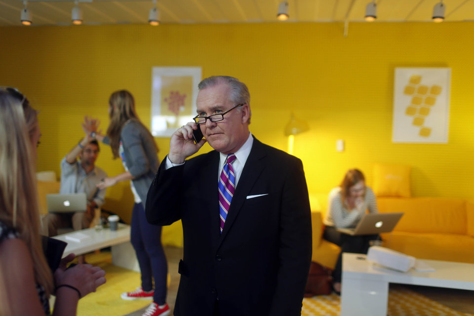 Photo - Tampa Mayor Bob Buckhorn makes a phone call from Google's home during the Democratic National Convention in Charlotte, N.C., on Wednesday, Sept. 5, 2012. (AP Photo/The Tampa Bay Times, Kathleen Flynn) TAMPA OUT; CITRUS COUNTY OUT; PORT CHARLOTTE OUT; BROOKSVILLE HERNANDO OUT; USA TODAY OUT; MAGS OUT ORG XMIT: FLPET101