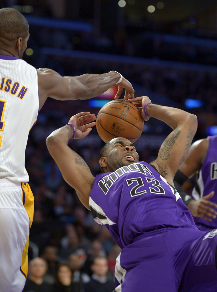 Sacramento Kings guard Marcus Thornton, right, has his shot blocked by Los Angeles Lakers forward Antawn Jamison during the first half of their NBA basketball game, Sunday, Nov. 11, 2012, in Los Angeles. (AP Photo/Mark J. Terrill)