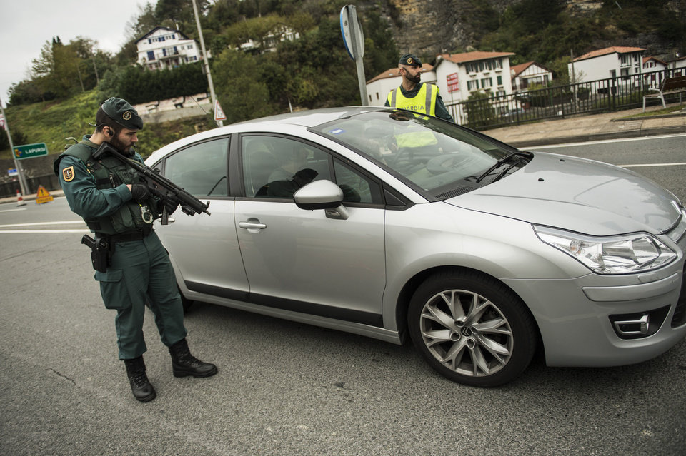 Photo - Spanish Civil Guards control  a car at a checkpoint in the frontier between Spain and France, in Irun, northern Spain, Saturday, Nov. 14, 2015, after more than 120 people were killed in attacks in Paris. (AP Photo/Alvaro Barrientos)