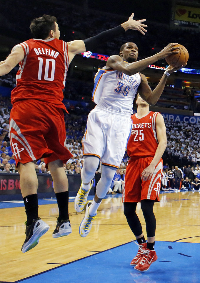 Oklahoma City's Kevin Durant (35) takes a shot between Houston's Carlos Delfino (10) and Chandler Parsons (25) during Game 2 in the first round of the NBA playoffs between the Oklahoma City Thunder and the Houston Rockets at Chesapeake Energy Arena in Oklahoma City, Wednesday, April 24, 2013. Oklahoma City won, 105-102. Photo by Nate Billings, The Oklahoman