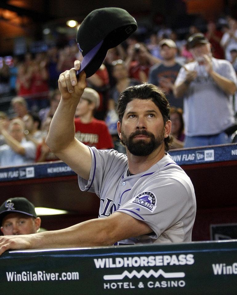 Photo - Colorado Rockies first baseman Todd Helton acknowledges the crowd in the second inning of a baseball game against the Arizona Diamondbacks after announcing his retirement at the end of the season on Sunday, Sept. 15, 2013, in Phoenix. (AP Photo/Rick Scuteri)