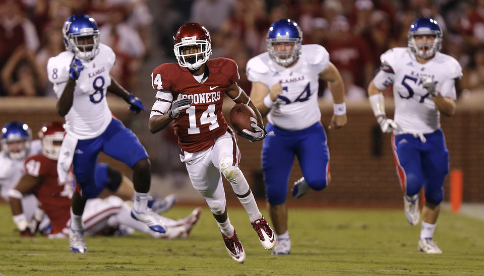 OU's Jalen Saunders (14) returns a kick against KU during the college football game between the University of Oklahoma Sooners (OU) and the University of Kansas Jayhawks (KU) at Gaylord Family-Oklahoma Memorial Stadium on Saturday, Oct. 20th, 2012, in Norman, Okla. Photo by Chris Landsberger, The Oklahoman