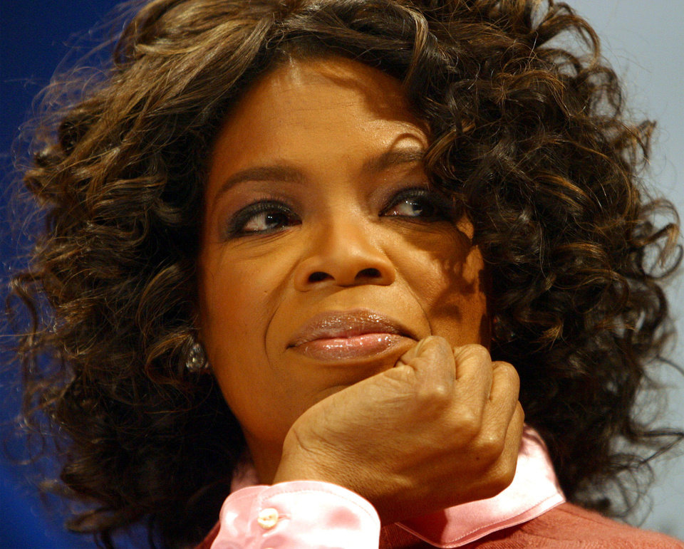 Oprah Winfrey listens to a question from the media during a press conference Saturday Dec. 11, 2004, in Oslo, Norway. Tom Cruise and Winfrey will be the hosts of the concert on Saturday for Nobel Peace Prize laureate Wangari Maathai. (AP Photo/John McConnico)