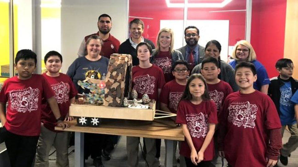 Photo -  Fourth-graders at Buchanan Elementary School recently won the Design+Do challenge with their parade float design featuring a roaring dragon that breathed