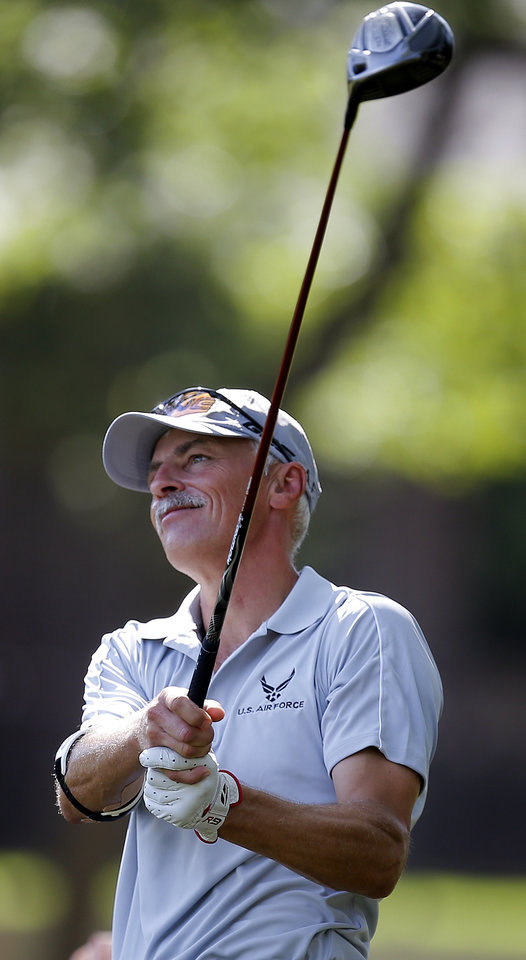 Photo - Mark Gardiner tees off  on No. 5 during a practice round for the U.S. Senior Open at Oak Tree National in Edmond, Okla., Tuesday, July 8, 2014. Photo by Bryan Terry, The Oklahoman