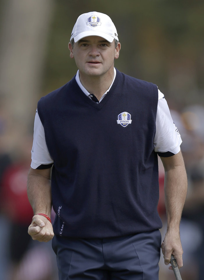 Europe's Paul Lawrie reacts after making a putt on the third hole during a singles match at the Ryder Cup PGA golf tournament Sunday, Sept. 30, 2012, at the Medinah Country Club in Medinah, Ill. (AP Photo/David J. Phillip)  ORG XMIT: PGA130