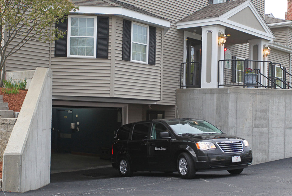 Photo - A vehicle believed to be carrying the body of Boston Marathon bombing suspect Tamerlan Tsarnaev backs into an underground garage at the Dyer-Lake Funeral Home, Thursday, May 2, 2013, in North Attleborough, Mass. The body of Tsarnaev, who was the subject of a massive manhunt and died after a gunbattle with police, was claimed on Thursday. (AP Photo/Stew Milne)