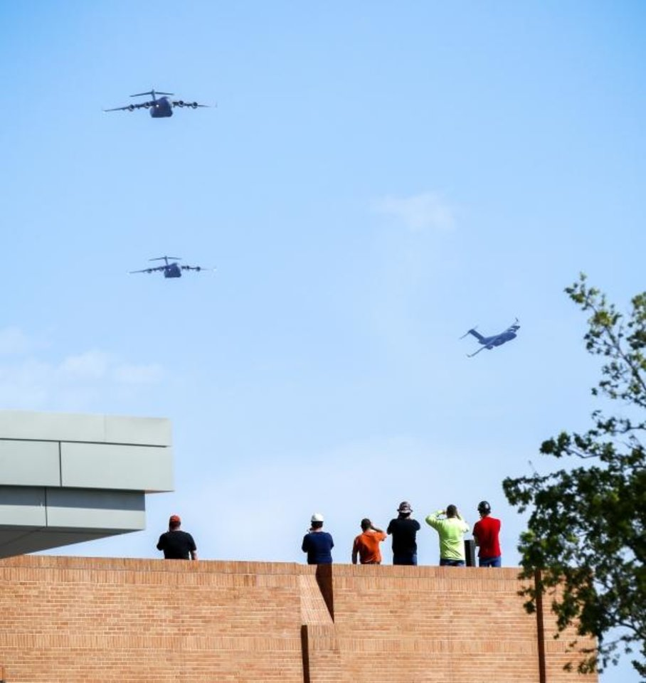 Photo -  It's been nearly seven months since flyovers honored frontline workers at Oklahoma City hospitals. Pictured here, C-17 Globemaster IIIs fly over Integris Baptist Medical Center on May 1. [The Oklahoman Archives]