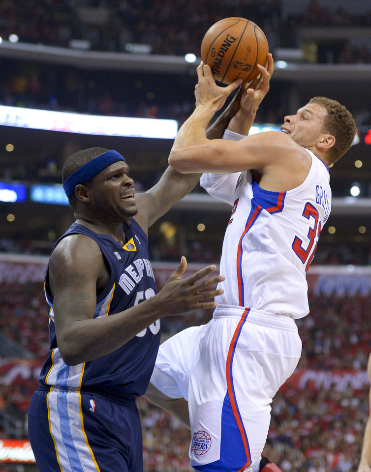 Photo - Los Angeles Clippers forward Blake Griffin, right, shoots over Memphis Grizzlies forward Zach Randolph during the first half of Game 2 of a first-round NBA basketball playoff series, Monday, April 22, 2013, in Los Angeles.  (AP Photo/Mark J. Terrill)