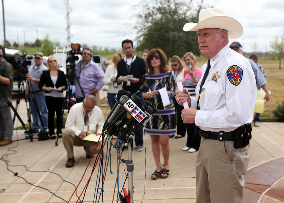 Photo - Kaufman County Sheriff David Byrnes, right, speaks at a news conference, Sunday, March 31, 2013, in Kaufman, Texas. On Saturday, Kaufman County District Attorney Mike McLelland and his wife, Cynthia, were murdered in their home. (AP Photo/Mike Fuentes)