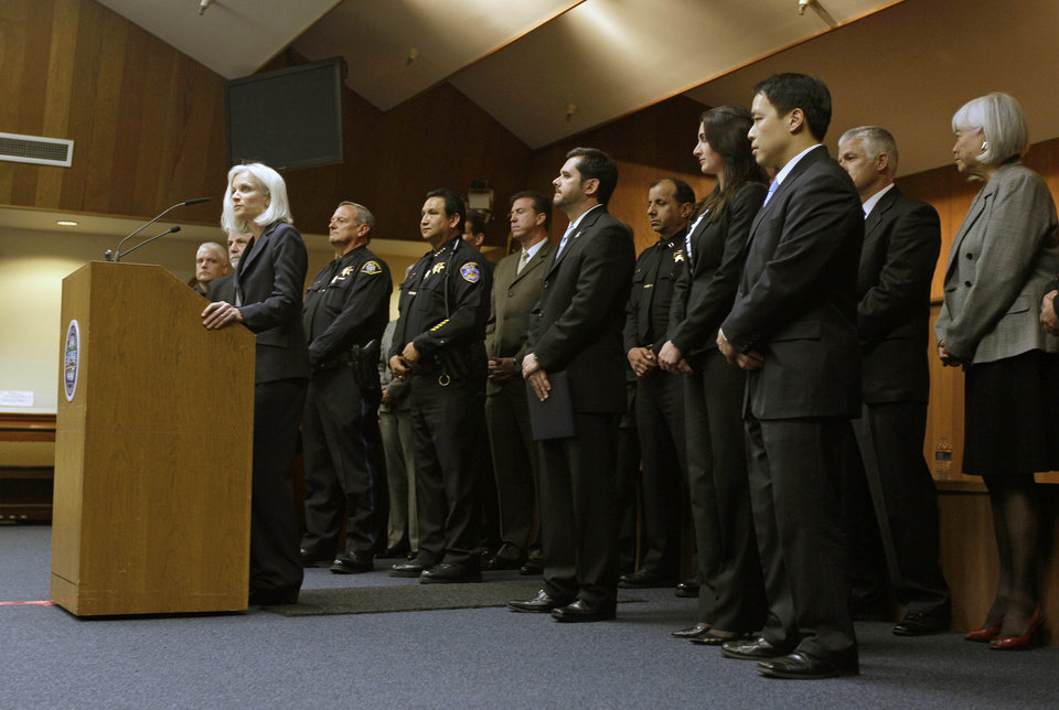 Photo -   United States Attorney Melinda Haag, with law enforcement representatives behind her, announces the arrests of 13 members and associates of the 500 Block/C Street gang during a news conference in South San Francisco, Calif., Thursday, May 3, 2012. Three Immigration and Customs Enforcement agents were shot and injured Thursday while serving