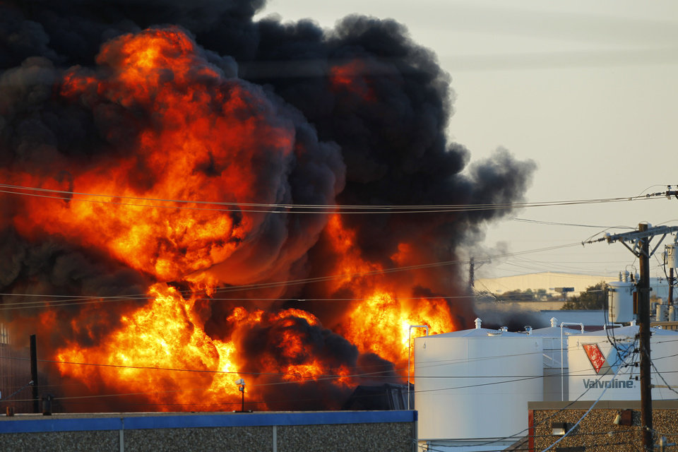 Fire and smoke rise as Dallas and Garland fire crews let a chemical fire burn off at the Nexeo Solutions plant in Garland, Texas, on Friday, Nov. 16, 2012. Fire Capt. Merrill Balanciere says it's still unclear what caused the fire, but the flames were fueled by highly flammable toluene and methanol. All 41 workers who were at the plant at the time of the fire are safe. (AP Photo/The Dallas Morning News, Tom Fox) MANDATORY CREDIT; MAGS OUT; TV OUT; INTERNET OUT; AP MEMBERS ONLY