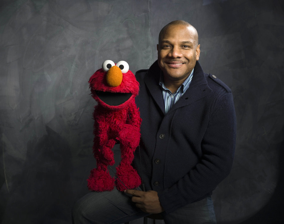 FILE - In this Jan. 24, 2011 file photo, Elmo puppeteer Kevin Clash poses with the