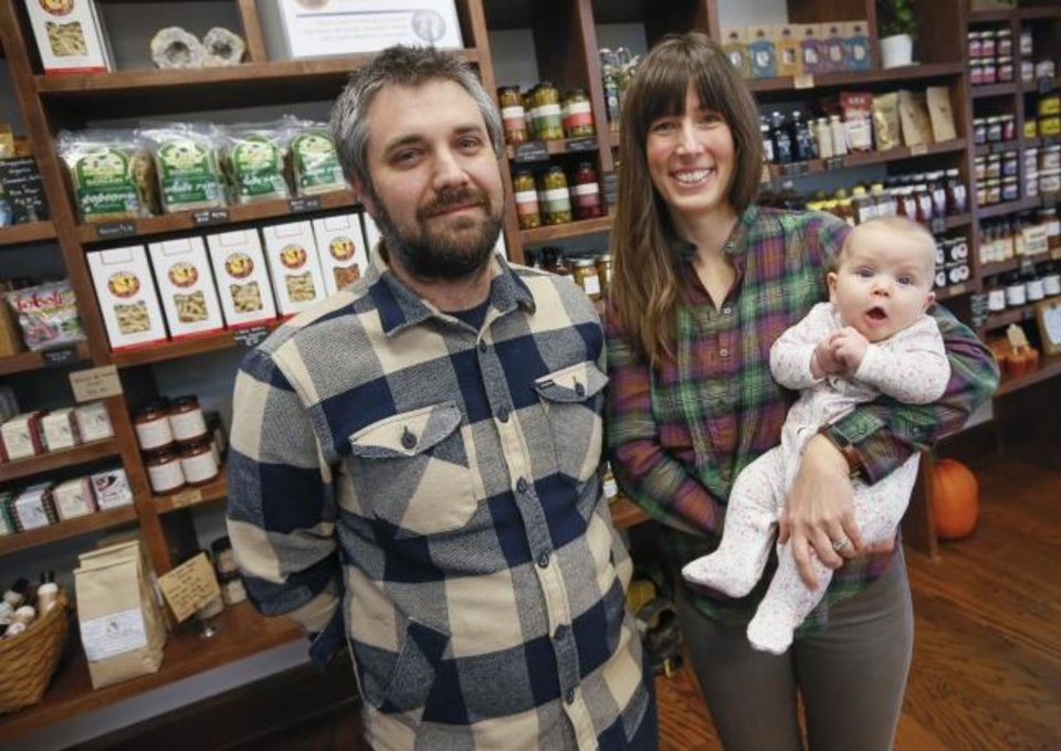 Photo -  Owners Matt Burch, left, and Chelsey Simpson, with Simpson's 4-month-old daughter, Julianne Simpson, inside Urban Agrarian, 1 E Main St., in Edmond. [Nate Billings/The Oklahoman]