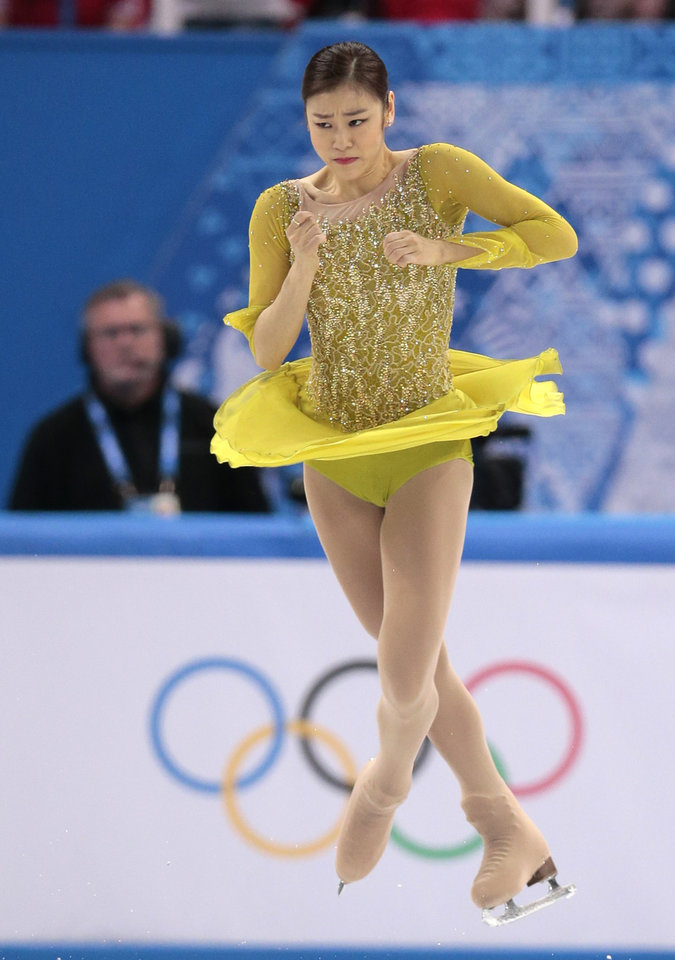 Photo - Yuna Kim of South Korea competes in the women's short program figure skating competition at the Iceberg Skating Palace during the 2014 Winter Olympics, Wednesday, Feb. 19, 2014, in Sochi, Russia. (AP Photo/Ivan Sekretarev)