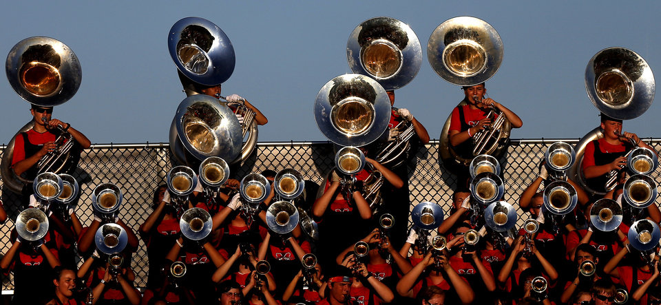 Photo - The Mustang band plays during a high school football game between Yukon and Mustang in Yukon, Okla., Friday, August 31, 2012. Photo by Bryan Terry, The Oklahoman