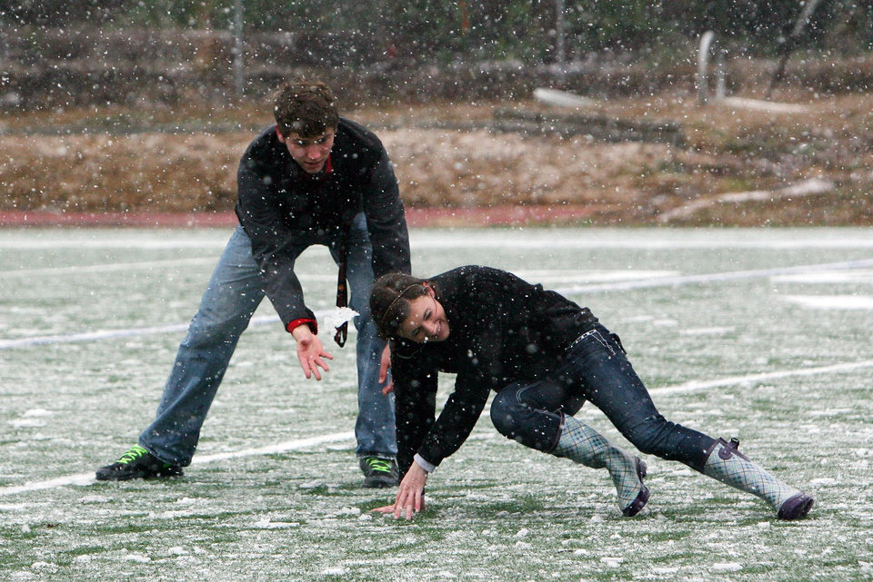 Photo - ACA students Phillip Brooks, 17, and Chandler Dare, 17, play in the snow on the school's football field in Tuscaloosa, Ala., Thursday, Jan. 17, 2013. Heavy snow fell across Tuscaloosa County Thursday. (AP Photo/Tuscaloosa News, Michelle Lepianka Carter)
