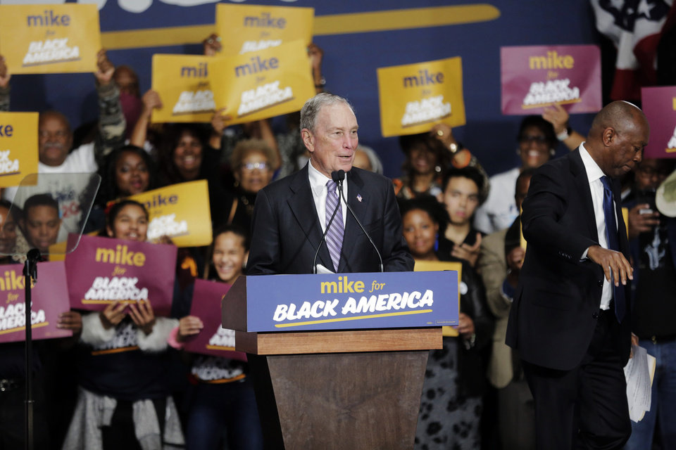 Photo -  Democratic presidential candidate and former New York City Mayor Michael Bloomberg speaks during a campaign rally Thursday at the Buffalo Soldier Museum in Houston. Houston Mayor Sylvester Turner stands at right. [Elizabeth Conley/Houston Chronicle via AP]