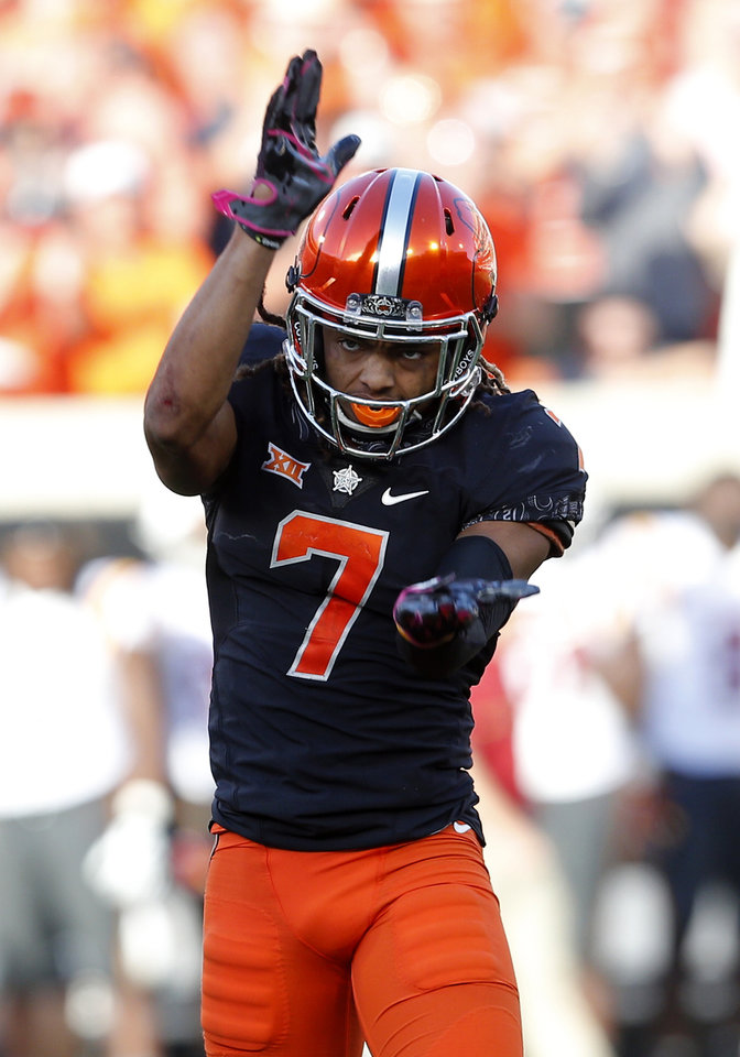 Photo - Oklahoma State's Ramon Richards (7) celebrates a defensive stop in the fourth quarter during a college football game between the Oklahoma State University Cowboys (OSU) and the Iowa State University at Boone Pickens Stadium in Stillwater, Okla., Saturday, Oct. 8, 2016. Photo by Sarah Phipps, The Oklahoman