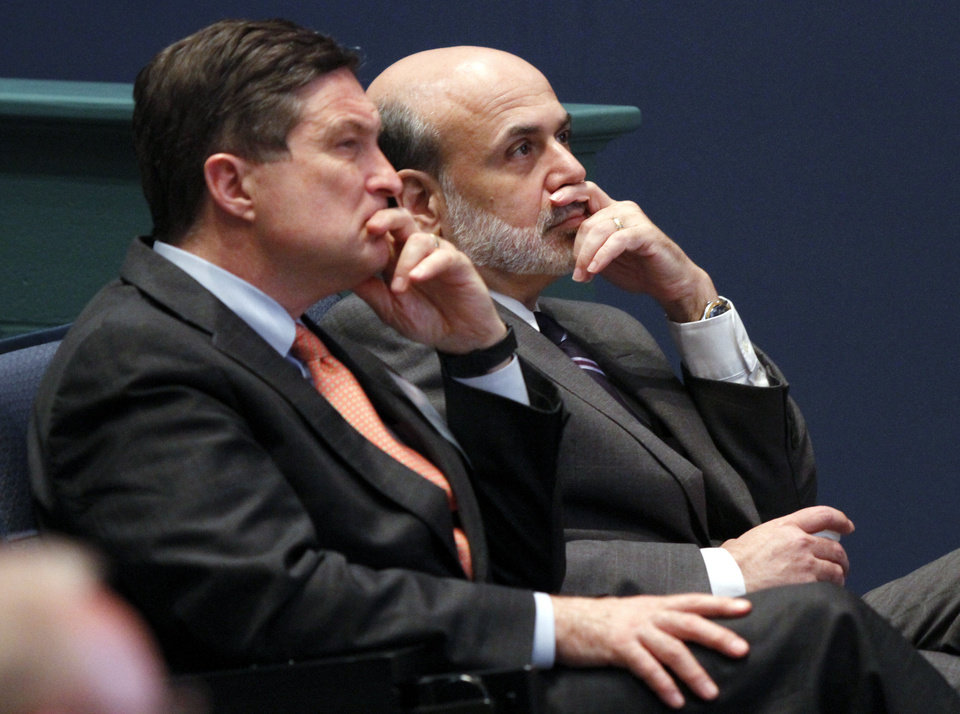 Federal Reserve Chairman, Ben Bernanke, right, listens with Jeffrey Lacker, left, president of the Federal Reserve of Richmond, at J. Sergeant Reynolds Community College in Richmond, Va., in June.  AP FILE PHOTO <strong>Steve Helber - AP</strong>